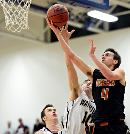 "Mead's Ryan Lozinski (4) goes up for a shot over Frederick's Michael Broz (10) during the game at Frederick High School on Friday, Feb. 1, 2013. Frederick beat Mead 50-40. For more photos visit  <a href=""http://www.BoCoPreps.com"">http://www.BoCoPreps.com</a><br /> (Greg Lindstrom/Times-Call)"