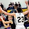 "Mead's Taylor Desch looks for an open teammate while Frederick's Christian Martinez (23) defends during the game at Frederick High School on Friday, Feb. 1, 2013. Frederick beat Mead 50-40. For more photos visit  <a href=""http://www.BoCoPreps.com"">http://www.BoCoPreps.com</a><br /> (Greg Lindstrom/Times-Call)"