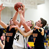 """Frederick's Ryan Miller (34) competes for a rebound against Mead's Ryan Lozinski (4) and Conor Lamb (11) during the game at Frederick High School on Friday, Feb. 1, 2013. Frederick beat Mead 50-40. For more photos visit  <a href=""""http://www.BoCoPreps.com"""">http://www.BoCoPreps.com</a><br /> (Greg Lindstrom/Times-Call)"""