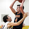 "Frederick's Michael Broz (10) pressures Mead's Ryan Lozinski (4) during the game at Frederick High School on Friday, Feb. 1, 2013. Frederick beat Mead 50-40. For more photos visit  <a href=""http://www.BoCoPreps.com"">http://www.BoCoPreps.com</a><br /> (Greg Lindstrom/Times-Call)"