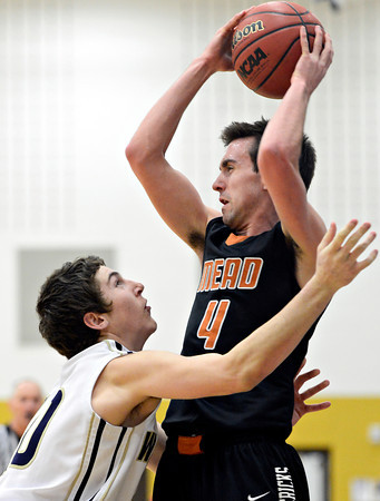 """Frederick's Michael Broz (10) pressures Mead's Ryan Lozinski (4) during the game at Frederick High School on Friday, Feb. 1, 2013. Frederick beat Mead 50-40. For more photos visit  <a href=""""http://www.BoCoPreps.com"""">http://www.BoCoPreps.com</a><br /> (Greg Lindstrom/Times-Call)"""