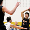 """Mead's Jacob Perez, right, looks for an open teammate during the game at Frederick High School on Friday, Feb. 1, 2013. Frederick beat Mead 50-40. For more photos visit  <a href=""""http://www.BoCoPreps.com"""">http://www.BoCoPreps.com</a><br /> (Greg Lindstrom/Times-Call)"""