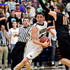 "Frederick's Christian Martinez (23) drives past Mead's Conor Lamb (11) during the game at Frederick High School on Friday, Feb. 1, 2013. Frederick beat Mead 50-40. For more photos visit  <a href=""http://www.BoCoPreps.com"">http://www.BoCoPreps.com</a><br /> (Greg Lindstrom/Times-Call)"