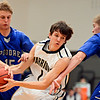 "Frederick's Chris Burgess (1) tries to hold onto the ball as Poudre's Tucker Clay (15) and Chandler Kahl defend during the game at Frederick High School on Wednesday, Nov. 28, 2012.  Frederick beat Poudre 53-51.  For more photos visit  <a href=""http://www.BoCoPreps.com"">http://www.BoCoPreps.com</a>.<br /> (Greg Lindstrom/Times-Call)"