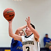 """Frederick's Lucas Adams (3) tries to shoot over Poudre's Tucker Clay in the first quarter during the game at Frederick High School on Wednesday, Nov. 28, 2012.  Frederick beat Poudre 53-51.  For more photos visit  <a href=""""http://www.BoCoPreps.com"""">http://www.BoCoPreps.com</a>.<br /> (Greg Lindstrom/Times-Call)"""