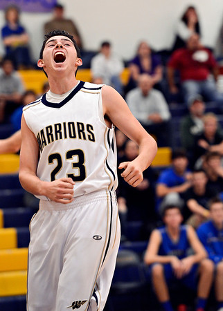 "Frederick's Christian Martinez (23) reacts after a play during the game at Frederick High School on Wednesday, Nov. 28, 2012.  Frederick beat Poudre 53-51.  For more photos visit  <a href=""http://www.BoCoPreps.com"">http://www.BoCoPreps.com</a>.<br /> (Greg Lindstrom/Times-Call)"