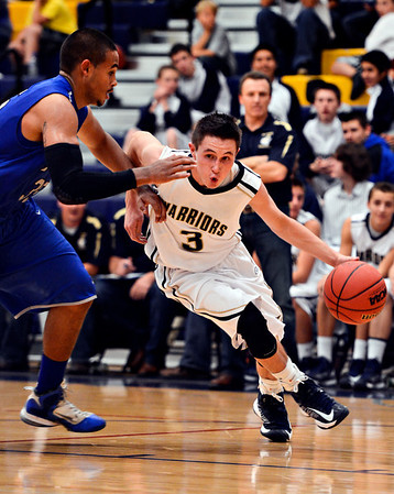 "Frederick's Lucas Adams (3) drives past Poudre's Lake Reed during the game at Frederick High School on Wednesday, Nov. 28, 2012.  Frederick beat Poudre 53-51.  For more photos visit  <a href=""http://www.BoCoPreps.com"">http://www.BoCoPreps.com</a>.<br /> (Greg Lindstrom/Times-Call)"