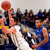 """Frederick's Lucas Adams, left, reaches for a ball during the game at Frederick High School on Wednesday, Nov. 28, 2012.  Frederick beat Poudre 53-51.  For more photos visit  <a href=""""http://www.BoCoPreps.com"""">http://www.BoCoPreps.com</a>.<br /> (Greg Lindstrom/Times-Call)"""