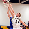 """Frederick's Ryan Miller (34) and Poudre's Zach Casey (4) compete for a rebound during the game at Frederick High School on Wednesday, Nov. 28, 2012.  Frederick beat Poudre 53-51.  For more photos visit  <a href=""""http://www.BoCoPreps.com"""">http://www.BoCoPreps.com</a>.<br /> (Greg Lindstrom/Times-Call)"""