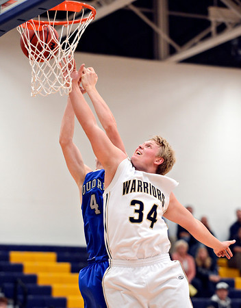 "Frederick's Ryan Miller (34) and Poudre's Zach Casey (4) compete for a rebound during the game at Frederick High School on Wednesday, Nov. 28, 2012.  Frederick beat Poudre 53-51.  For more photos visit  <a href=""http://www.BoCoPreps.com"">http://www.BoCoPreps.com</a>.<br /> (Greg Lindstrom/Times-Call)"