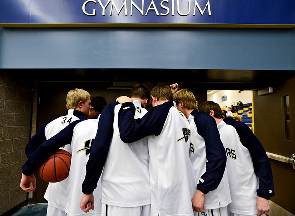 """The Frederick team huddles before the game at Frederick High School on Wednesday, Nov. 28, 2012.  Frederick beat Poudre 53-51.  For more photos visit  <a href=""""http://www.BoCoPreps.com"""">http://www.BoCoPreps.com</a>.<br /> (Greg Lindstrom/Times-Call)"""