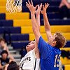 "Frederick's Lucas Adams (3) stretches for a rebound against Poudre's Tucker Clay (15) during the game at Frederick High School on Wednesday, Nov. 28, 2012.  Frederick beat Poudre 53-51.  For more photos visit  <a href=""http://www.BoCoPreps.com"">http://www.BoCoPreps.com</a>.<br /> (Greg Lindstrom/Times-Call)"