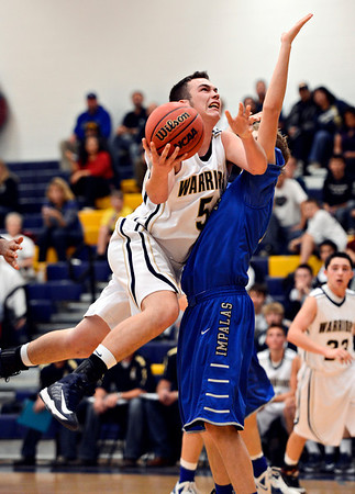 """Frederick's Jayden McGraw (5) tries to shoot over Poudre's Tucker Clay during the game at Frederick High School on Wednesday, Nov. 28, 2012.  Frederick beat Poudre 53-51.  For more photos visit  <a href=""""http://www.BoCoPreps.com"""">http://www.BoCoPreps.com</a>.<br /> (Greg Lindstrom/Times-Call)"""
