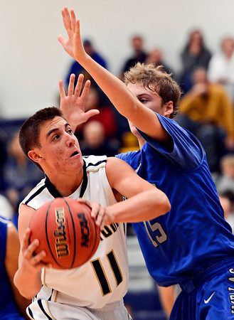 "Frederick's Austin Rivera (11) is defended by Poudre's Tucker Clay (15) during the game at Frederick High School on Wednesday, Nov. 28, 2012.  Frederick beat Poudre 53-51.  For more photos visit  <a href=""http://www.BoCoPreps.com"">http://www.BoCoPreps.com</a>.<br /> (Greg Lindstrom/Times-Call)"