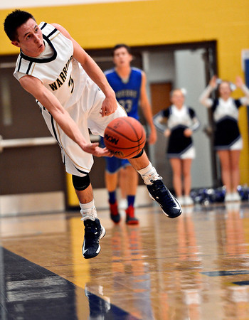 """Frederick's Lucas Adams (3) saves a ball during the game at Frederick High School on Wednesday, Nov. 28, 2012.  Frederick beat Poudre 53-51.  For more photos visit  <a href=""""http://www.BoCoPreps.com"""">http://www.BoCoPreps.com</a>.<br /> (Greg Lindstrom/Times-Call)"""