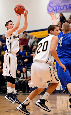 """Frederick's Lucas Adams makes the game-winning 3-pointer with 10 seconds remaining in the fourth quarter during the game at Frederick High School on Wednesday, Nov. 28, 2012.  Frederick beat Poudre 53-51.  For more photos visit  <a href=""""http://www.BoCoPreps.com"""">http://www.BoCoPreps.com</a>.<br /> (Greg Lindstrom/Times-Call)"""