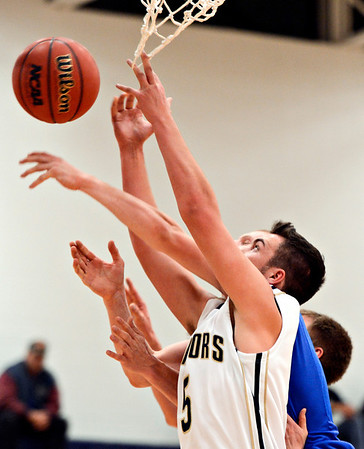 """Frederick's Jayden McGraw competes for a rebound during the game at Frederick High School on Wednesday, Nov. 28, 2012.  Frederick beat Poudre 53-51.  For more photos visit  <a href=""""http://www.BoCoPreps.com"""">http://www.BoCoPreps.com</a>.<br /> (Greg Lindstrom/Times-Call)"""
