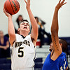 """Frederick's Jayden McGraw (5) shoots over Poudre's Lake Reed during the game at Frederick High School on Wednesday, Nov. 28, 2012.  Frederick beat Poudre 53-51.  For more photos visit  <a href=""""http://www.BoCoPreps.com"""">http://www.BoCoPreps.com</a>.<br /> (Greg Lindstrom/Times-Call)"""