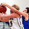 "Frederick's Ryan Miller  (34) is fouled by Poudre's Sawyer Finley during the game at Frederick High School on Wednesday, Nov. 28, 2012.  Frederick beat Poudre 53-51.  For more photos visit  <a href=""http://www.BoCoPreps.com"">http://www.BoCoPreps.com</a>.<br /> (Greg Lindstrom/Times-Call)"