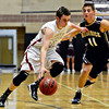"Silver Creek's Zane Lindsey tries to drive past Frederick's Austin Rivera during the game at Silver Creek High School on Friday, Dec. 14, 2012. For more photos visit  <a href=""http://www.BoCoPreps.com"">http://www.BoCoPreps.com</a>.<br /> (Greg Lindstrom/Times-Call)"