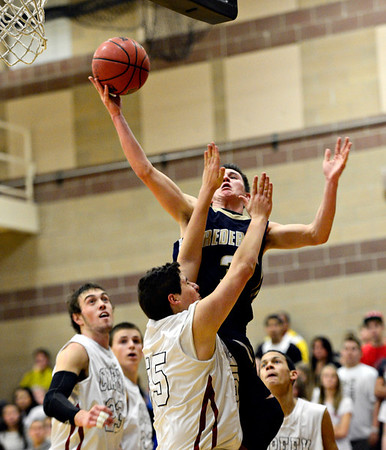 "Frederick's Lucas Adams goes up for a shot over Silver Creek's Francisco Echevarria during the game at Silver Creek High School on Friday, Dec. 14, 2012. For more photos visit  <a href=""http://www.BoCoPreps.com"">http://www.BoCoPreps.com</a>.<br /> (Greg Lindstrom/Times-Call)"