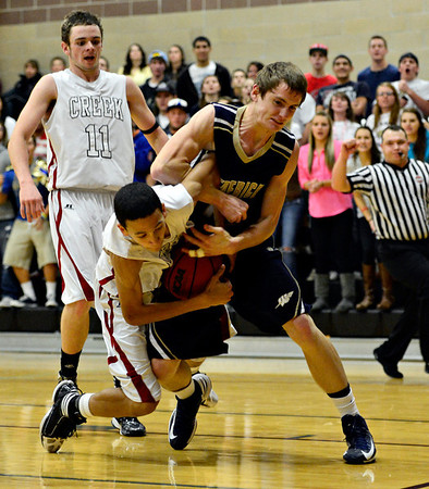 "Silver Creek's Eric Machmuller, left, is fouled by Frederick's Joe Wise during the game at Silver Creek High School on Friday, Dec. 14, 2012. For more photos visit  <a href=""http://www.BoCoPreps.com"">http://www.BoCoPreps.com</a>.<br /> (Greg Lindstrom/Times-Call)"