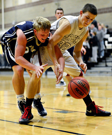 "Frederick's Ryan Miller, left, and Silver Creek's Luke Goforth compete for a loose ball during the game at Silver Creek High School on Friday, Dec. 14, 2012. For more photos visit  <a href=""http://www.BoCoPreps.com"">http://www.BoCoPreps.com</a>.<br /> (Greg Lindstrom/Times-Call)"