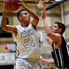"Silver Creek's Josh Tarin (51) looks for an open teammate as he is defended by Frederick's Austin Rivera during the game at Silver Creek High School on Friday, Dec. 14, 2012. For more photos visit  <a href=""http://www.BoCoPreps.com"">http://www.BoCoPreps.com</a>.<br /> (Greg Lindstrom/Times-Call)"
