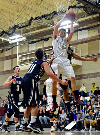 "Silver Creek's Luke Goforth (32) grabs a rebound during the game at Silver Creek High School on Friday, Dec. 14, 2012. For more photos visit  <a href=""http://www.BoCoPreps.com"">http://www.BoCoPreps.com</a>.<br /> (Greg Lindstrom/Times-Call)"