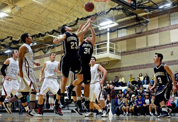 "Frederick's Christian Martinez (23) and Ryan Miller (34) reach for a rebound during the game at Silver Creek High School on Friday, Dec. 14, 2012. For more photos visit  <a href=""http://www.BoCoPreps.com"">http://www.BoCoPreps.com</a>.<br /> (Greg Lindstrom/Times-Call)"