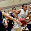 "Silver Creek's Trey Fleming, center, tries to drive past Frederick defenders during the game at Silver Creek High School on Friday, Dec. 14, 2012. For more photos visit  <a href=""http://www.BoCoPreps.com"">http://www.BoCoPreps.com</a>.<br /> (Greg Lindstrom/Times-Call)"