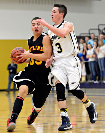 """Skyline's Luciano Quesada (35) tries to drive past Frederick's Lucas Adams (3) during the game at Frederick High School on Friday, Jan. 25, 2013. Skyline beat Frederick 62-51. For more photos visit  <a href=""""http://www.BoCoPreps.com"""">http://www.BoCoPreps.com</a>.<br /> (Greg Lindstrom/Times-Call)"""