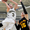 """Frederick's Lucas Adams (3) goes up for a shot over Skyline's Colton Dabney (15) during the game at Frederick High School on Friday, Jan. 25, 2013. Skyline beat Frederick 62-51. For more photos visit  <a href=""""http://www.BoCoPreps.com"""">http://www.BoCoPreps.com</a>.<br /> (Greg Lindstrom/Times-Call)"""