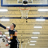 """Skyline's Colton Dabney blocks a shot by Frederick's Jayden McGraw (5) during the game at Frederick High School on Friday, Jan. 25, 2013. Skyline beat Frederick 62-51. For more photos visit  <a href=""""http://www.BoCoPreps.com"""">http://www.BoCoPreps.com</a>.<br /> (Greg Lindstrom/Times-Call)"""