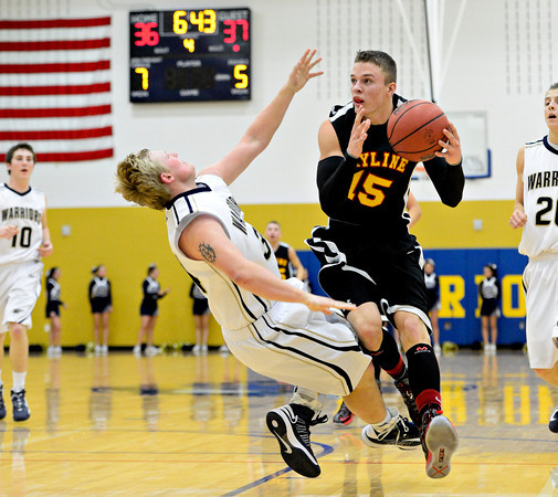 "Frederick's Ryan Miller, left, draws a charge against Skyline's Colton Dabney (15) during the game at Frederick High School on Friday, Jan. 25, 2013. Skyline beat Frederick 62-51. For more photos visit  <a href=""http://www.BoCoPreps.com"">http://www.BoCoPreps.com</a>.<br /> (Greg Lindstrom/Times-Call)"