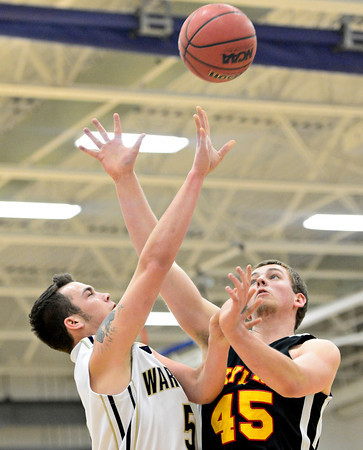 "Frederick's Jayden McGraw (5) shoots over Skyline's Zach Anthony (45) during the game at Frederick High School on Friday, Jan. 25, 2013. Skyline beat Frederick 62-51. For more photos visit  <a href=""http://www.BoCoPreps.com"">http://www.BoCoPreps.com</a>.<br /> (Greg Lindstrom/Times-Call)"