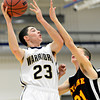 """Frederick's Christian Martinez (23) shoots over Skyline's Dustin Mandrell (21) during the game at Frederick High School on Friday, Jan. 25, 2013. Skyline beat Frederick 62-51. For more photos visit  <a href=""""http://www.BoCoPreps.com"""">http://www.BoCoPreps.com</a>.<br /> (Greg Lindstrom/Times-Call)"""