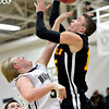 "Frederick's Ryan Miller, left, blocks a shot by Skyline's Colton Dabney during the game at Frederick High School on Friday, Jan. 25, 2013. Skyline beat Frederick 62-51. For more photos visit  <a href=""http://www.BoCoPreps.com"">http://www.BoCoPreps.com</a>.<br /> (Greg Lindstrom/Times-Call)"