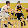 "Skyline's Dustin Mandrell (21) drives past Frederick's Michael Broz during the game at Frederick High School on Friday, Jan. 25, 2013. Skyline beat Frederick 62-51. For more photos visit  <a href=""http://www.BoCoPreps.com"">http://www.BoCoPreps.com</a>.<br /> (Greg Lindstrom/Times-Call)"