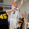 """Frederick's Lucas Adams (3) goes up for a shot over Skyline's Zach Anthony (45) an Luciano Quesada (35) during the game at Frederick High School on Friday, Jan. 25, 2013. Skyline beat Frederick 62-51. For more photos visit  <a href=""""http://www.BoCoPreps.com"""">http://www.BoCoPreps.com</a>.<br /> (Greg Lindstrom/Times-Call)"""