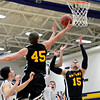 "Skylien's Zach Anthony (45) and Colton Dabney (15) stretch for a rebound against Frederick players during the game at Frederick High School on Friday, Jan. 25, 2013. Skyline beat Frederick 62-51. For more photos visit  <a href=""http://www.BoCoPreps.com"">http://www.BoCoPreps.com</a>.<br /> (Greg Lindstrom/Times-Call)"