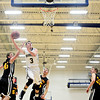 "Frederick's Lucas Adams goes up for a shot over Skyline defenders during the game at Frederick High School on Friday, Jan. 25, 2013. Skyline beat Frederick 62-51. For more photos visit  <a href=""http://www.BoCoPreps.com"">http://www.BoCoPreps.com</a>.<br /> (Greg Lindstrom/Times-Call)"