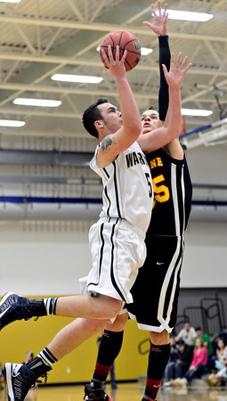 "Skyline's Colton Dabney (15) goes up to block a shot by Frederick's Jayden McGraw (5) during the game at Frederick High School on Friday, Jan. 25, 2013. Skyline beat Frederick 62-51. For more photos visit  <a href=""http://www.BoCoPreps.com"">http://www.BoCoPreps.com</a>.<br /> (Greg Lindstrom/Times-Call)"