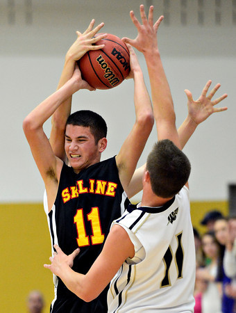 "Frederick's Austin Rivera, right, and Alex Therrien, back, pressure Skyline's Aaron Soriano during the game at Frederick High School on Friday, Jan. 25, 2013. Skyline beat Frederick 62-51. For more photos visit  <a href=""http://www.BoCoPreps.com"">http://www.BoCoPreps.com</a>.<br /> (Greg Lindstrom/Times-Call)"