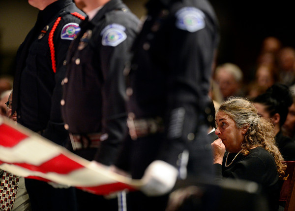 Longmont Police Department Color Guard fold the American flag during the funeral of retired Longmont firefighter Lynn Huff Friday morning Feb. 15, 2013 at LifeBridge Christian Church before presenting it to Huff's wife Barbara, right. (Lewis Geyer/Times-Call)