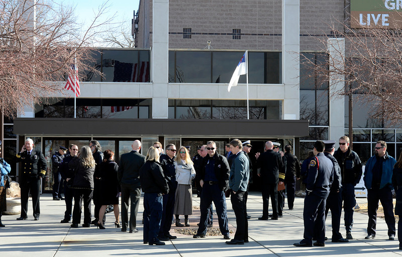People wait outside before the start of the funeral of retired Longmont firefighter Lynn Huff Friday morning Feb. 15, 2013 at LifeBridge Christian Church. (Lewis Geyer/Times-Call)
