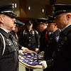 The Longmont Police Department honor guard rehearses before the funeral of retired Longmont firefighter Lynn Huff Friday morning Feb. 15, 2013 at LifeBridge Christian Church. Huff, 60, died Saturday while hiking in Hawaii. Huff retired in 2010 as a division chief after 32 years with the Longmont Fire Department. (Lewis Geyer/Times-Call)