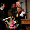 Assistant Longmont fire chief Rick Vandervelde hugs Barbara Huff, wife of retired Longmont firefighter Lynn Huff, at his funeral Friday morning Feb. 15, 2013 at LifeBridge Christian Church. (Lewis Geyer/Times-Call)