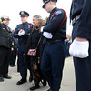 Longmont Police Department Color Guard lead Barbara Huff, wife of retired Longmont firefighter Lynn Huff, out of the funeral Friday morning Feb. 15, 2013 at LifeBridge Christian Church. (Lewis Geyer/Times-Call)