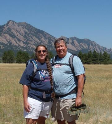 Retired Longmont fire division chief Lynn Huff, right, died Saturday during a hiking accident in Maui, Hawaii. Huff is pictured in this photo next to his wife, Barbara. (File photo)